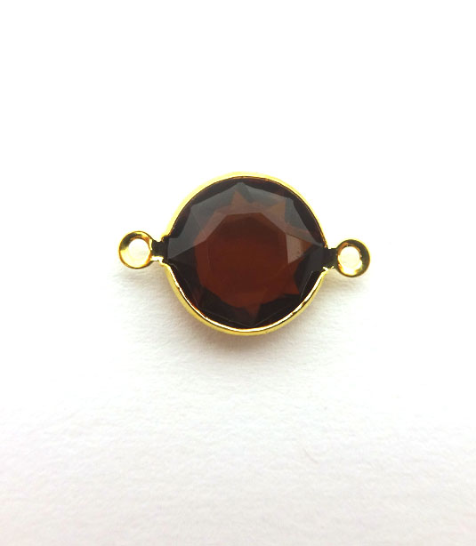 ROUND BROWN TRANSPARENT COLOR WITH GOLD PLATED FRAME 20x12mm